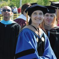 Faculty in formal Commencement regalia.