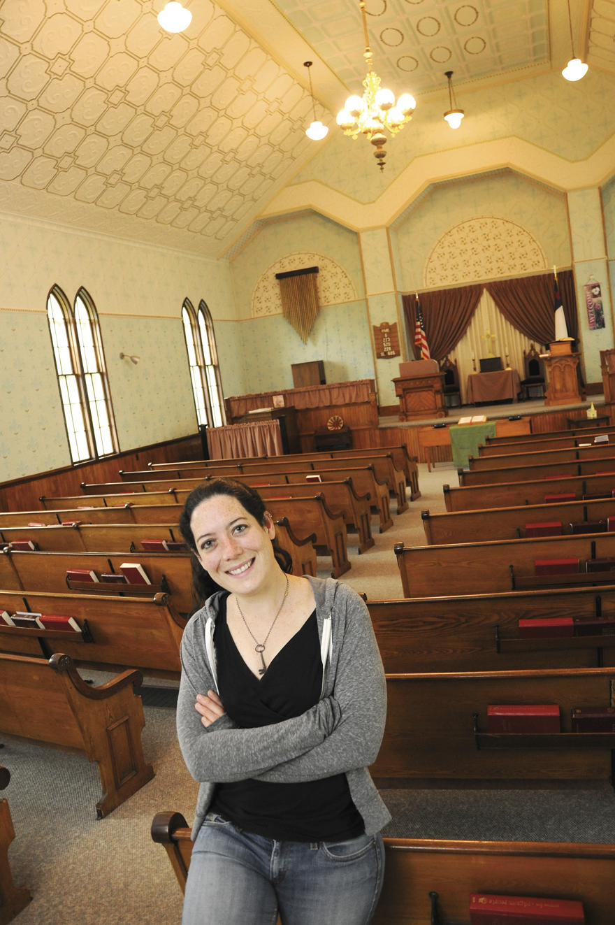 Mae Williams '14G and the interior of the beautiful Bath Congregational Church she helped to get listed on the NH Historical Register. Jon Gilbert Fox photo.