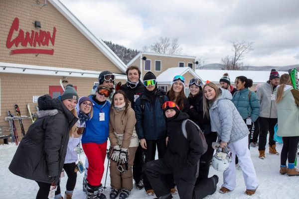 Group of students posing in front of Cannon Mountain Resort