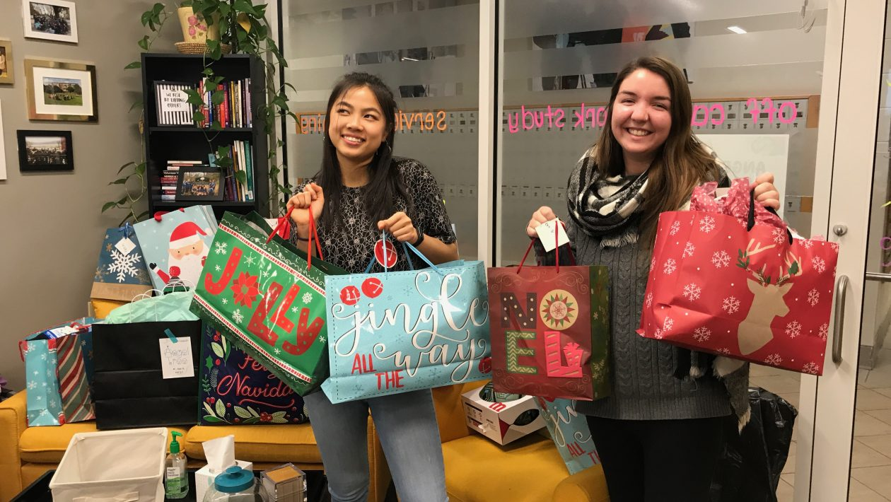 Students pose with gift donations