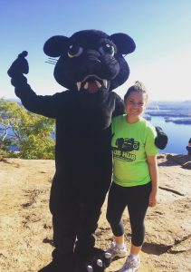 Girl and PSU mascot on top of mountain