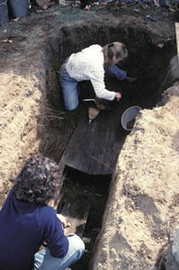 """April 23, 2005—the second """"modern"""" exhumation of Jane McCrea's grave. The exposed coffin, containing the bones, is the new one placed in the grave in 2003."""