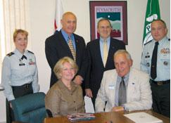 (Seated L-R) Provost Barry and Ernest Loomis prepare to sign the statement of support as Maj. Angela Maxner, commander of N.H. Army National Guard Recruiting and Retention; Col. (Ret.) Ted Kehr, ESGR executive director; Gerry Boyle, ESGR Region 4 chair and Sgt. Maj. Jim Gross, N.H. Army National Guard Retention SGM, look on.