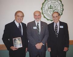 Bill Marston '54, President Donald P. Wharton and Charlie Marston '64G in September 2002 when Bill was inducted into Plymouth State's Hall of Fame for athletic accomplishments in basketball and baseball.