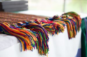 At the ceremony, graduates were presented with rainbow cords to wear with their caps and gowns at Commencement. Nina Weinstein '15 photo.