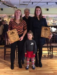 "Clockwise from right: Lariviere; 3-year-old Ari Beaulieu of Whitefield, NH; Lariviere's teammate Alicia Bates; and Coach Bonnie Lord. The field hockey team ""adopted"" Ari, who has been battling cancer, as an honorary team member last year. Lariviere and Bates were honored with PSU Field Hockey's Gold Award for their extraordinary support of Ari, who was recently diagnosed as cancer-free."
