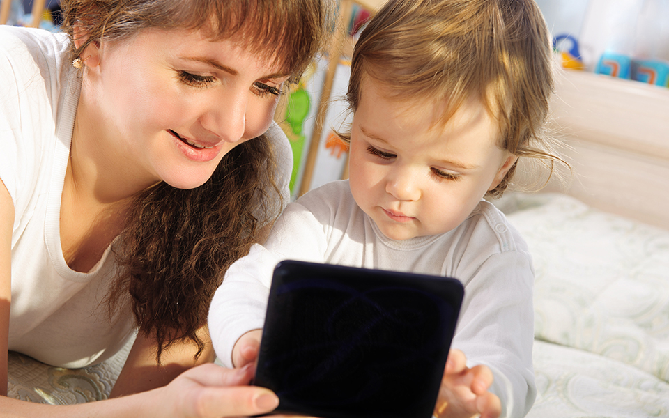 mother and child using technology