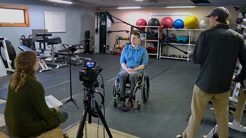 PSU students Sidney Copp '17 and Ian Coull '17 interviewed Lancaster fitness entrepreneur Peter Rizzo in his fitness facility RizFit Training Studio as part of the Lancaster initiative. RizFit is dedicated to getting people of all abilities, healthy results. PSU students worked with Rizzo to create a marketing plan and a GoFundMe page. Ian Halter photo.