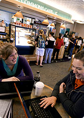 Two students enjoy a laugh during lunch in the Commons Cafe.