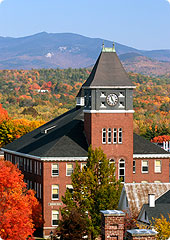 Iconic Rounds Hall Tower against the backdrop of fall foliage and the White Mountains.